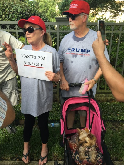 Susan Edwards, her husband and their Yorkie, Ms. Veronica, speak to the media outside of a June 18 Donald Trump fundraiser in Houston.