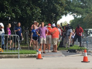Donald Trump supporters speak to the media and face protesters at a fundraiser in Houston June 18.